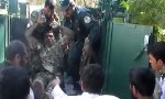 An injured Afghan army soldier is taken to hospital in Farah after a suicide attack on a courthouse