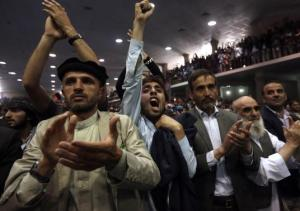 Supporters of Afghan presidential candidate Abdullah Abdullah shout slogans during a gathering in Kabul