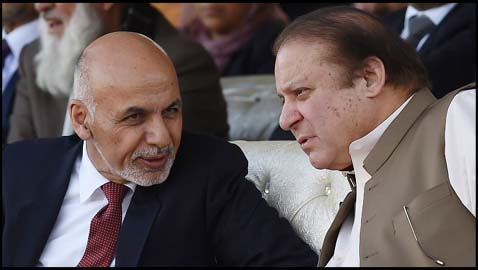 Pakistani Prime Minister Nawaz Sharif (R) and Afghan President Ashraf Ghani (L) speak as they watch a cricket match between teams from Pakistan and Afghanistan at the Prime Minister's house in Islamabad on November 15, 2014. Pakistan and Afghanistan pledged to begin a new era of economic cooperation, with Afghan President Ashraf Ghani saying three days of talks had ended 13 years of differences. AFP PHOTO/Farooq NAEEM