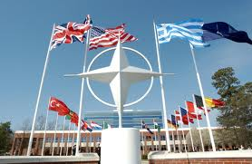 NATO symbol, flags and HQ